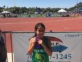 081516_LUSD_SHOTPUT: Jasmine Landeros, a third-grader at Washington Elementary, poses with her ribbon after winning fourth place in the shotput throw at the California State Games in Escondido.