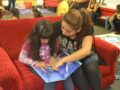 """091416_LUSD_READING2: Cecilia Cordova (right) teaches younger sister Alexa, an Abbott Elementary first-grader, how to read """"Cinderella"""" inside Abbott's new Reading Oasis during the Sept. 14 grand opening. The facility is a dedicated space for students to settle in, grab a book and spark their literary imaginations during their off-time on campus."""
