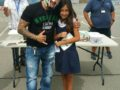 SYSDMYSTERIO2: La Mirada Elementary fourth-grader Elizabeth Carrara is one of seven students who won tickets to Viva La Lucha: Live In The 619 during a school visit by Rey Mysterio.